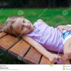 Lay Down Chair Outside Hanging Chairs Outdoor Cute Little Girl Lying On Wooden In Stock
