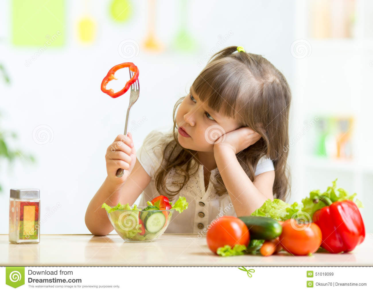 cute little girl not wanting to eat healthy food kid kitchen 51018099