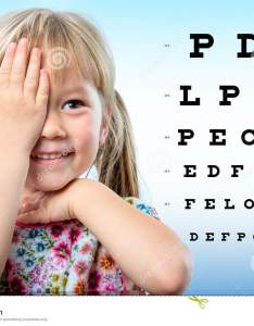 Cute little girl reviewing eyesight on chart also stock image of rh dreamstime