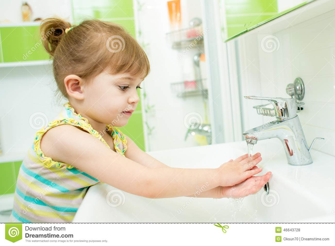 Cute Little Girl Washing Her Hands In Bathroom Stock Photo