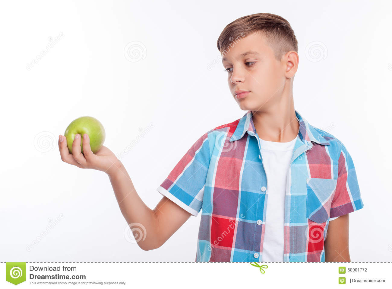 Cute Male Teenager Is Eating Healthy Food Stock Photo
