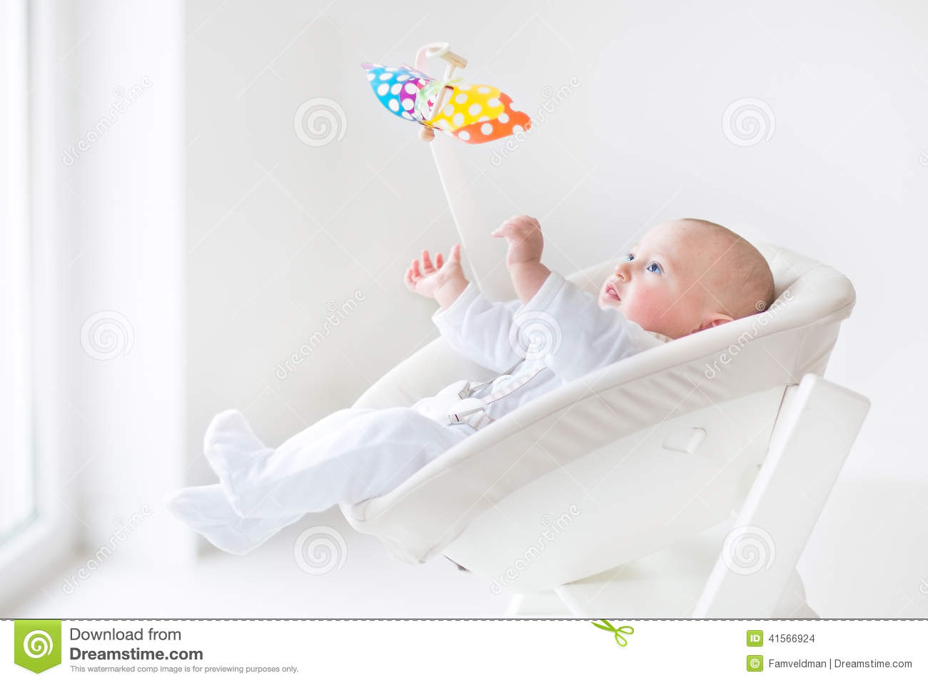 infant feeding chair cheap rental covers cute newborn baby boy watching colorful mobile toy stock photo - image: 41566924