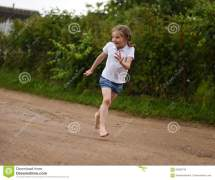 Cute Smiling Little Girl Running Barefoot In