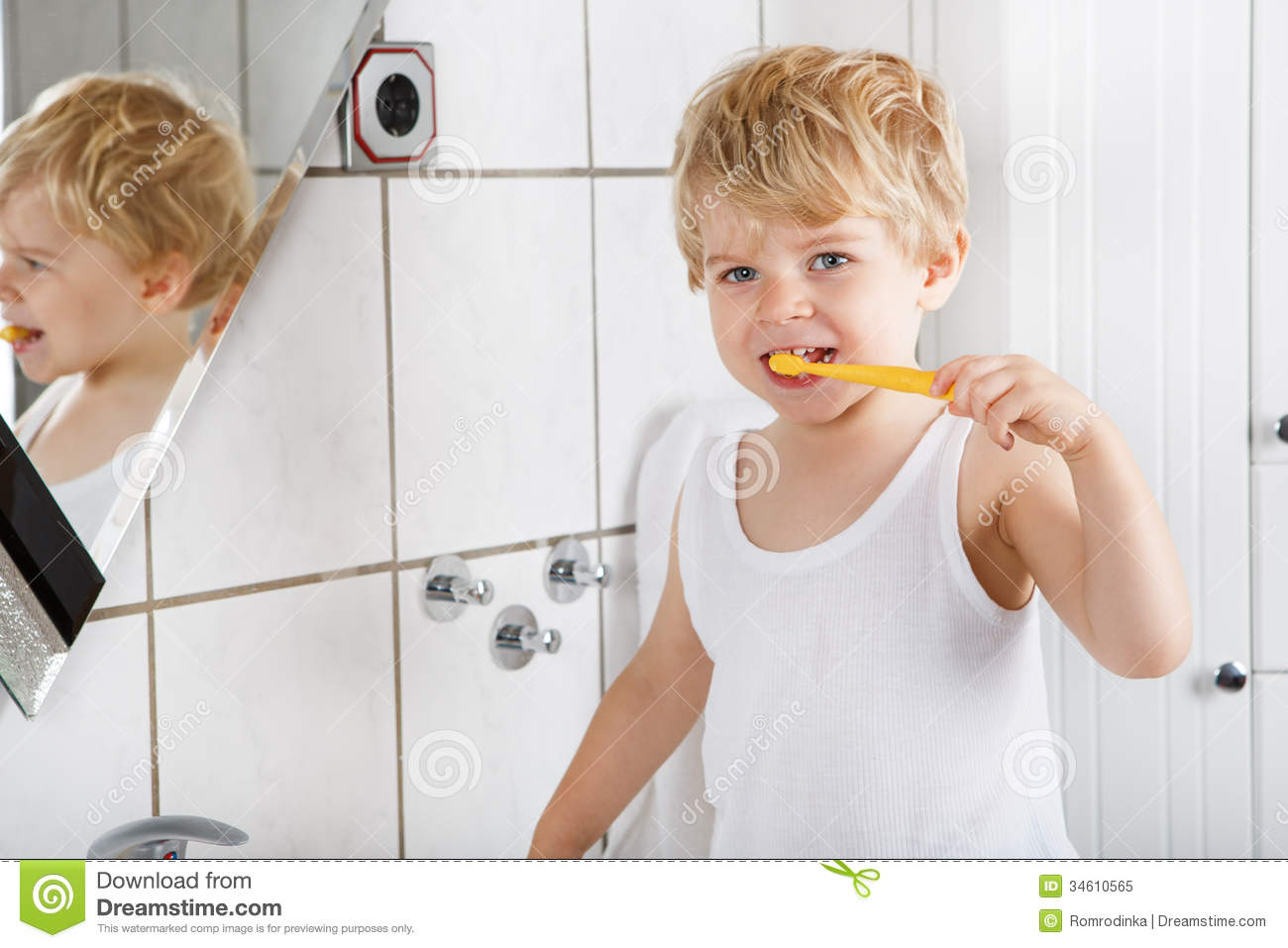 Cute Toddler With Blue Eyes And Blond Hair Brushing His