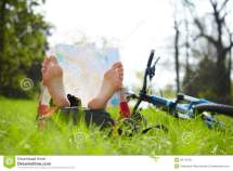Cyclist Reads Map Lying Barefoot Green Grass Outdoors