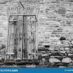 Window Shutter Of Rural House With Brick Wall And Ancient