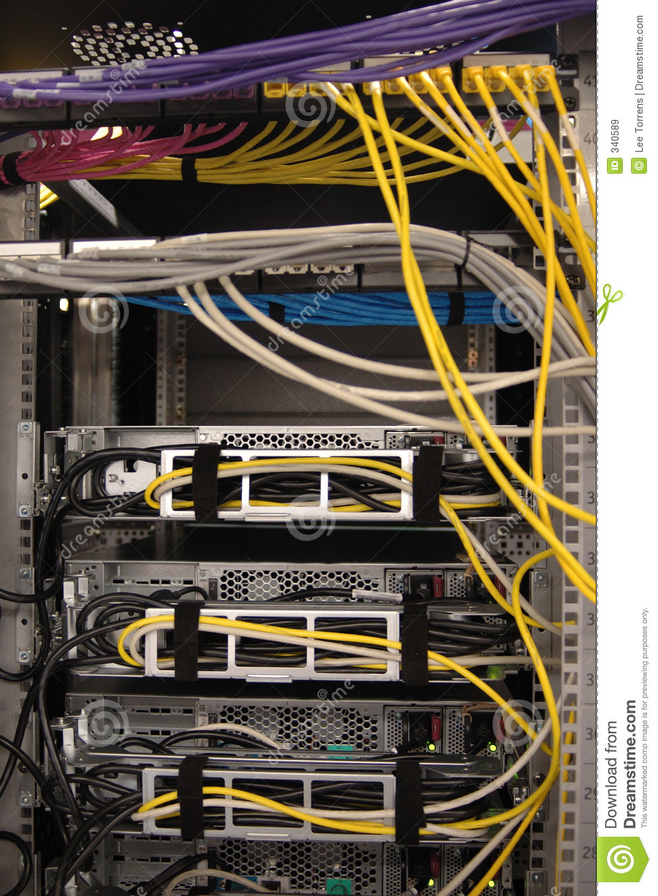 hight resolution of the rear of a server rack populated with servers this shows colour coded cable patching implemented in a neat and professional manner