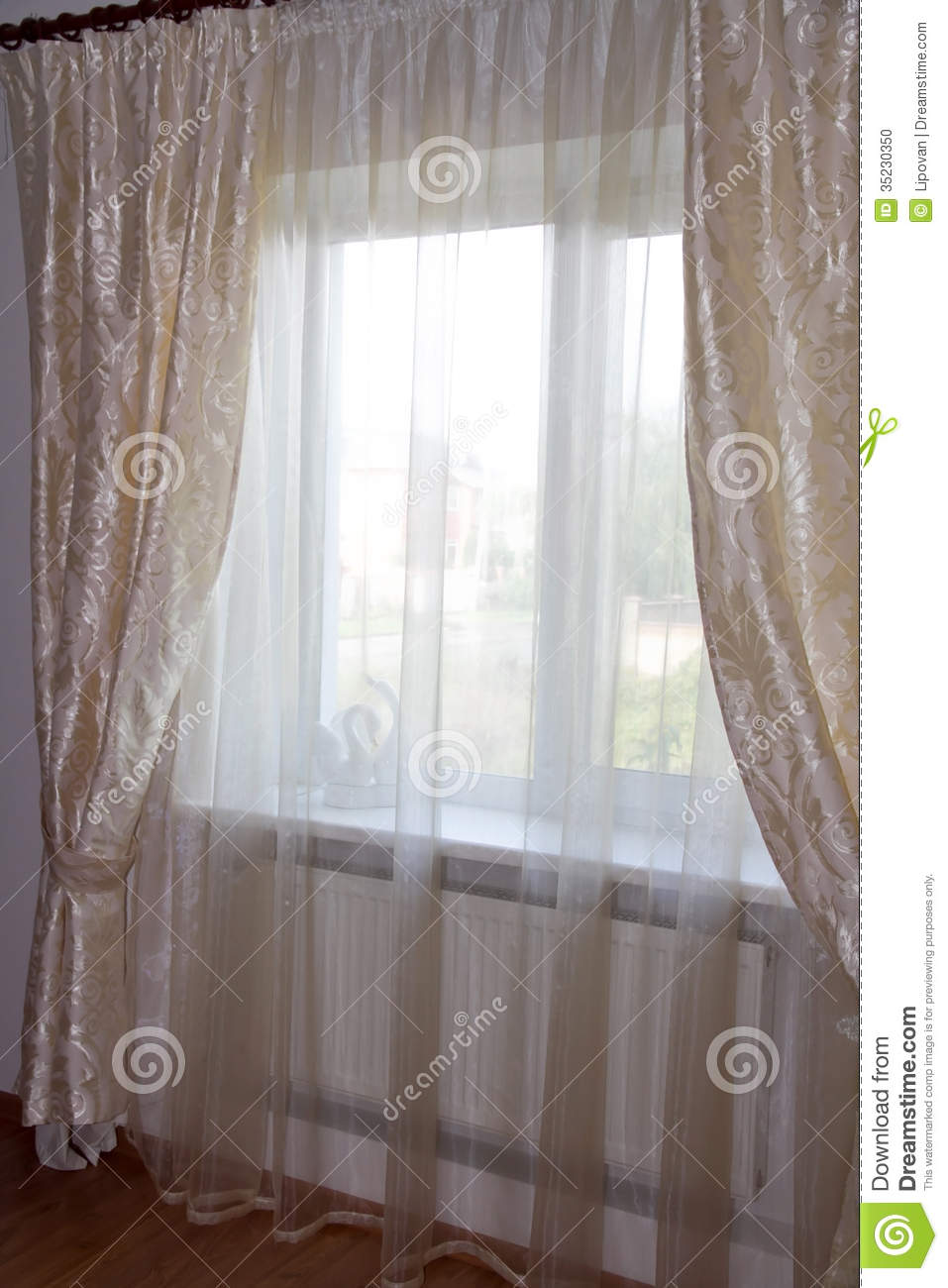 Decorating Windows  Cream Curtains In The Bedroom Stock