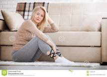 Middle Aged Barefoot Woman Sitting Floor Embracing