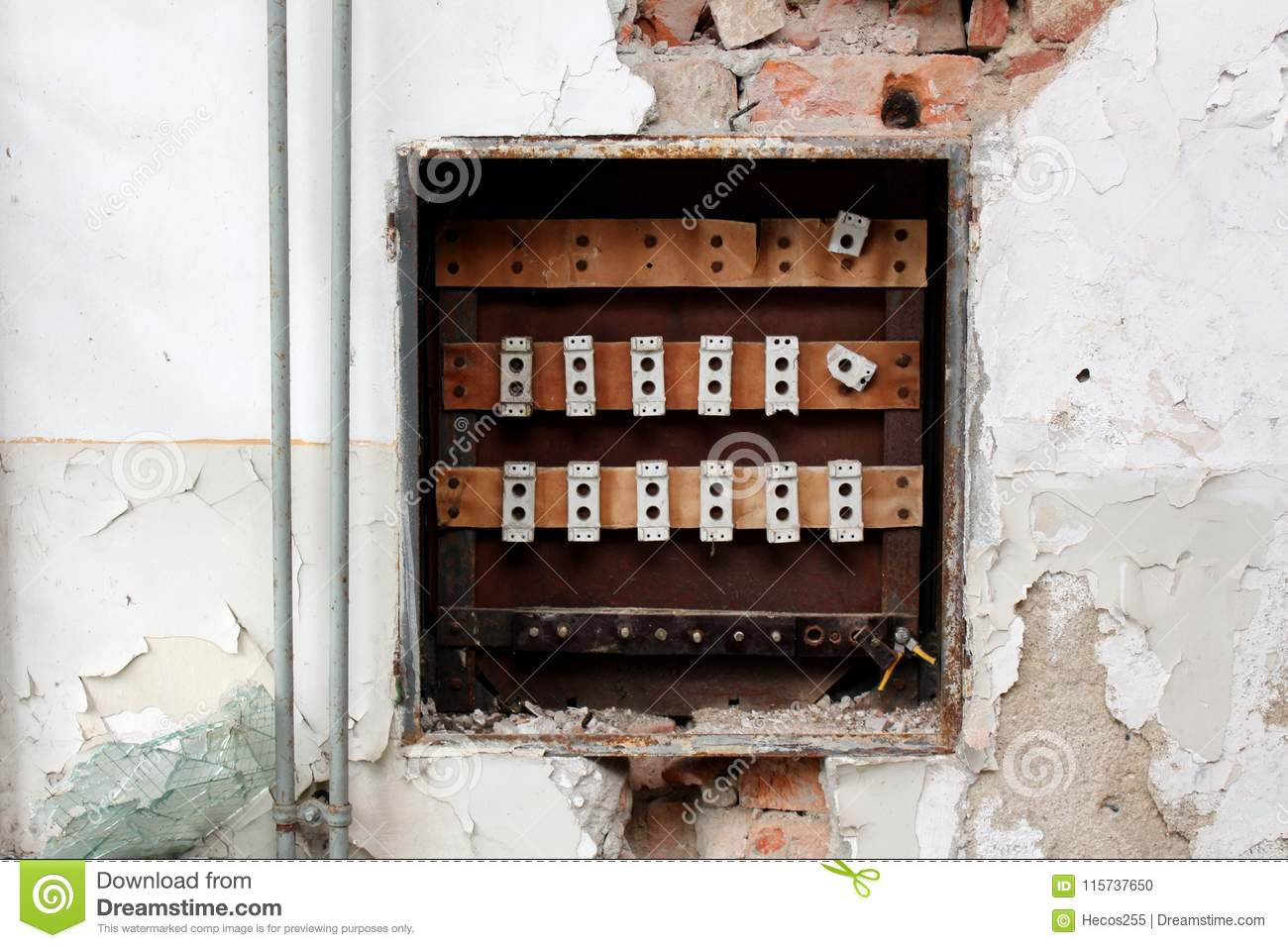 hight resolution of destroyed rusted old fuse box surrounded with crumbling wall visible bricks radiator pipes and broken glass