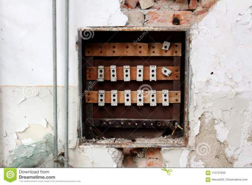 small resolution of destroyed rusted old fuse box surrounded with crumbling wall visible bricks radiator pipes and broken glass