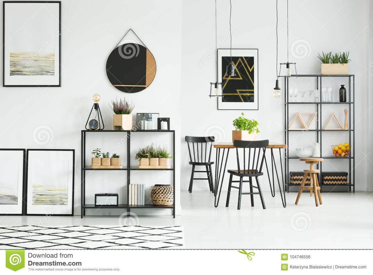 Dining room with posters stock photo Image of lampshades