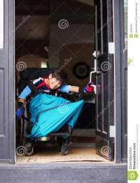 Disabled Boy In Wheelchair Opening Door Stock Photography