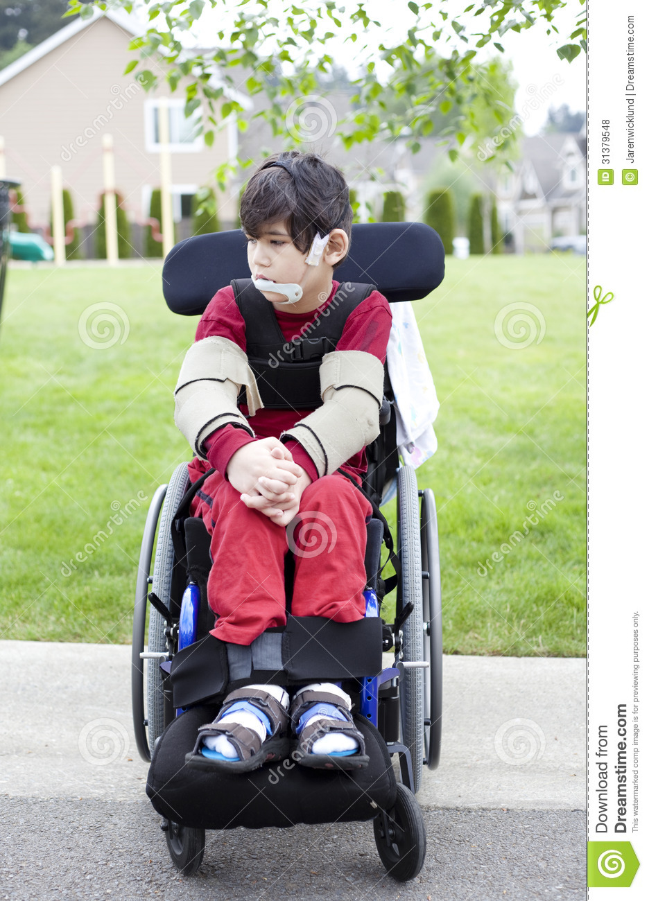 Disabled Little Boy In Wheelchair Outdoors Stock Photo