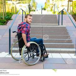Wheelchair Man American Leather Swing Chair Disabled In Front Of Stairs Stock Photo