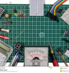diy electrical maker tools components on green cutting mat board  [ 1300 x 987 Pixel ]