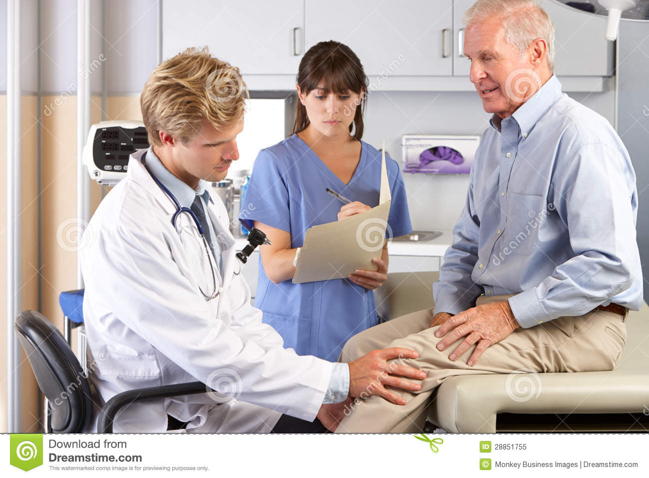 Doctor Examining Male Patient With Knee Pain Stock Image