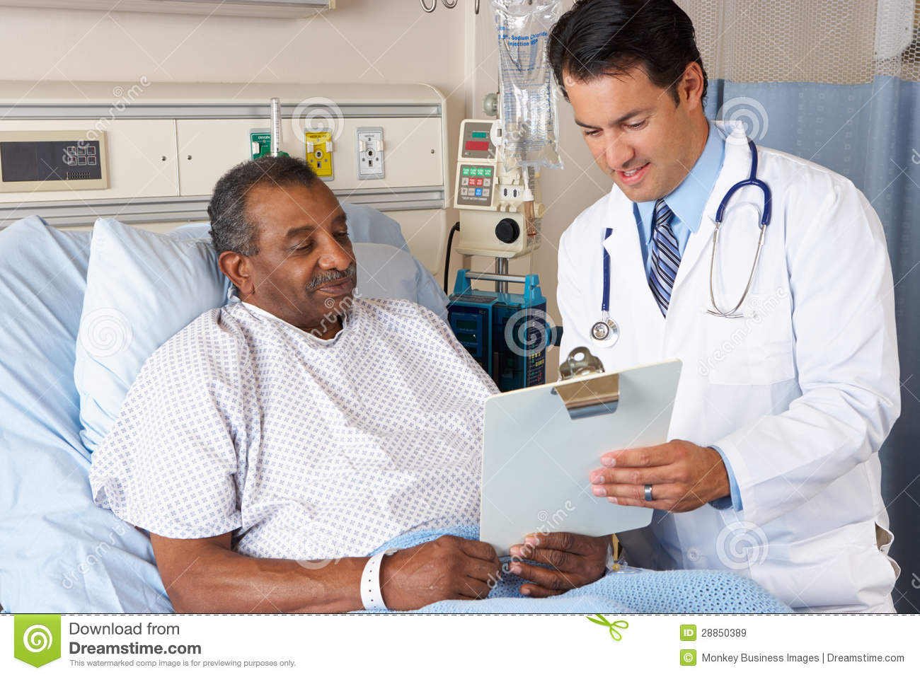 Doctor Explaining Consent Form To Senior Patient Royalty