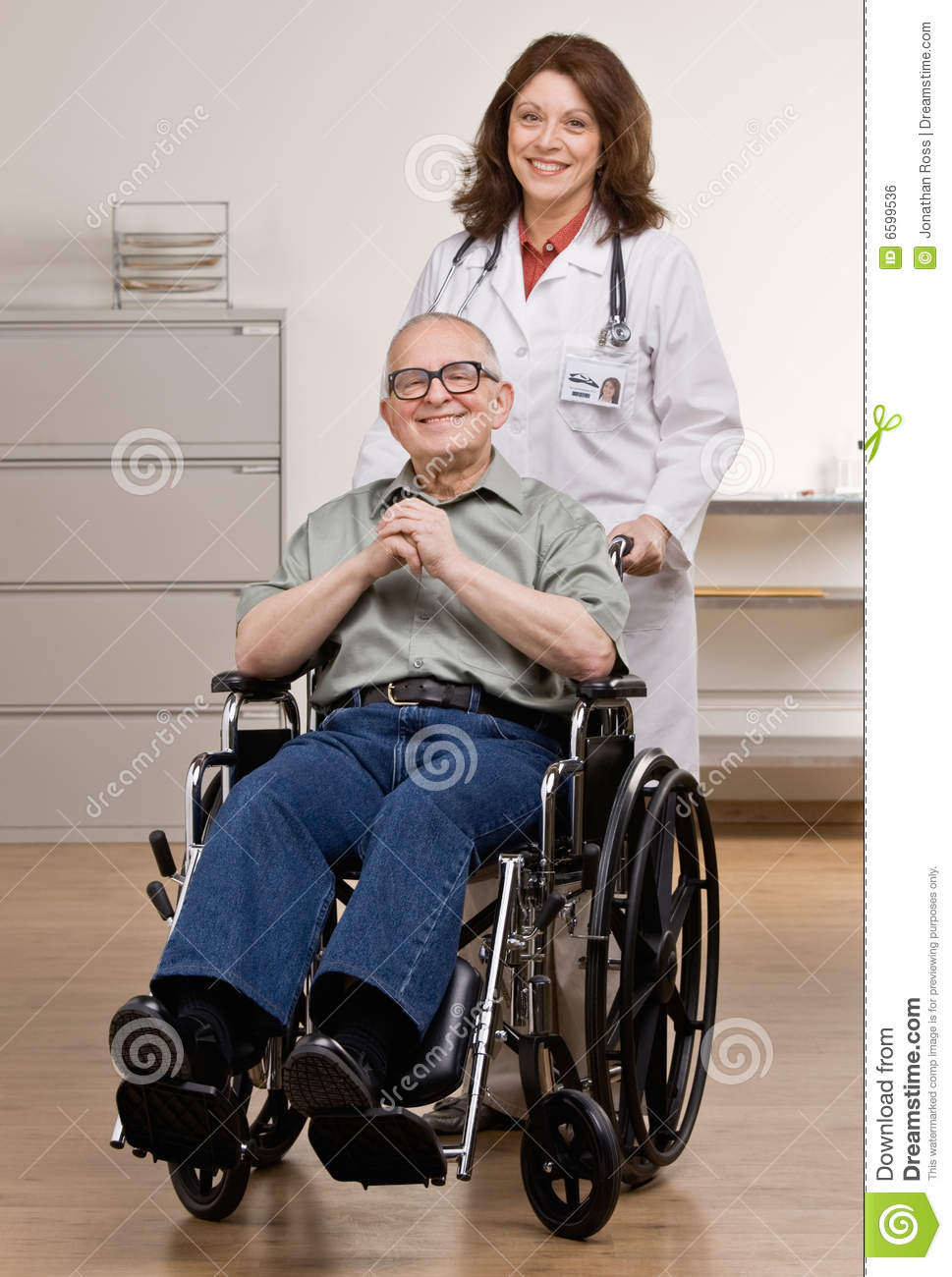 senior citizen chair cover vinyl doctor pushing disabled patient in wheel royalty free stock image - image: 6599536