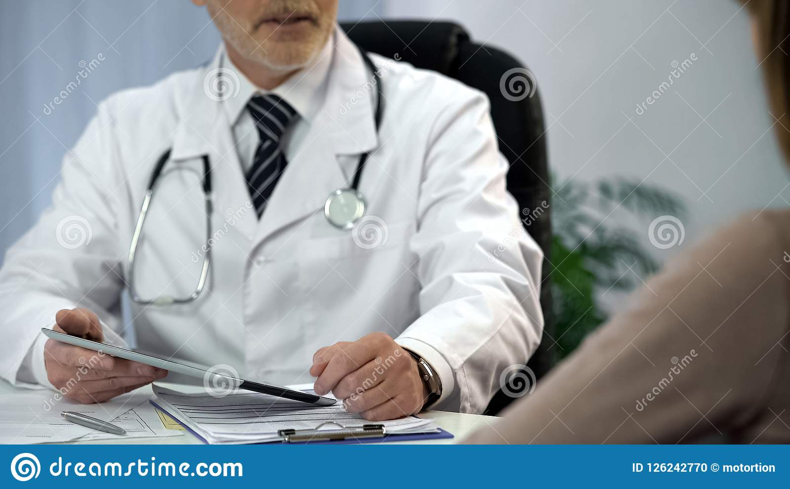 Doctor Talking To Patient Holding Tablet Withysis