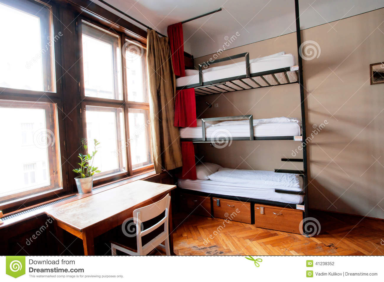 cheap dorm chairs steel easy chair with cloth room of hostel level beds stock photo