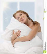 Dreamy Beauty Girl Hugging Pillow While In Bed Stock Image ...