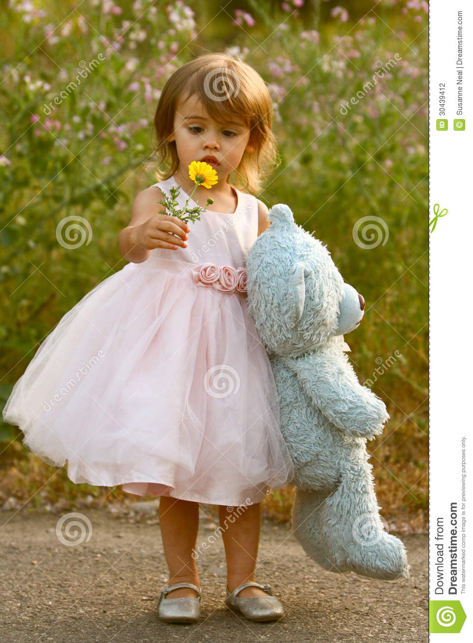 Dressy Twoyearold Girl In Pink Dress Holding Stuffed