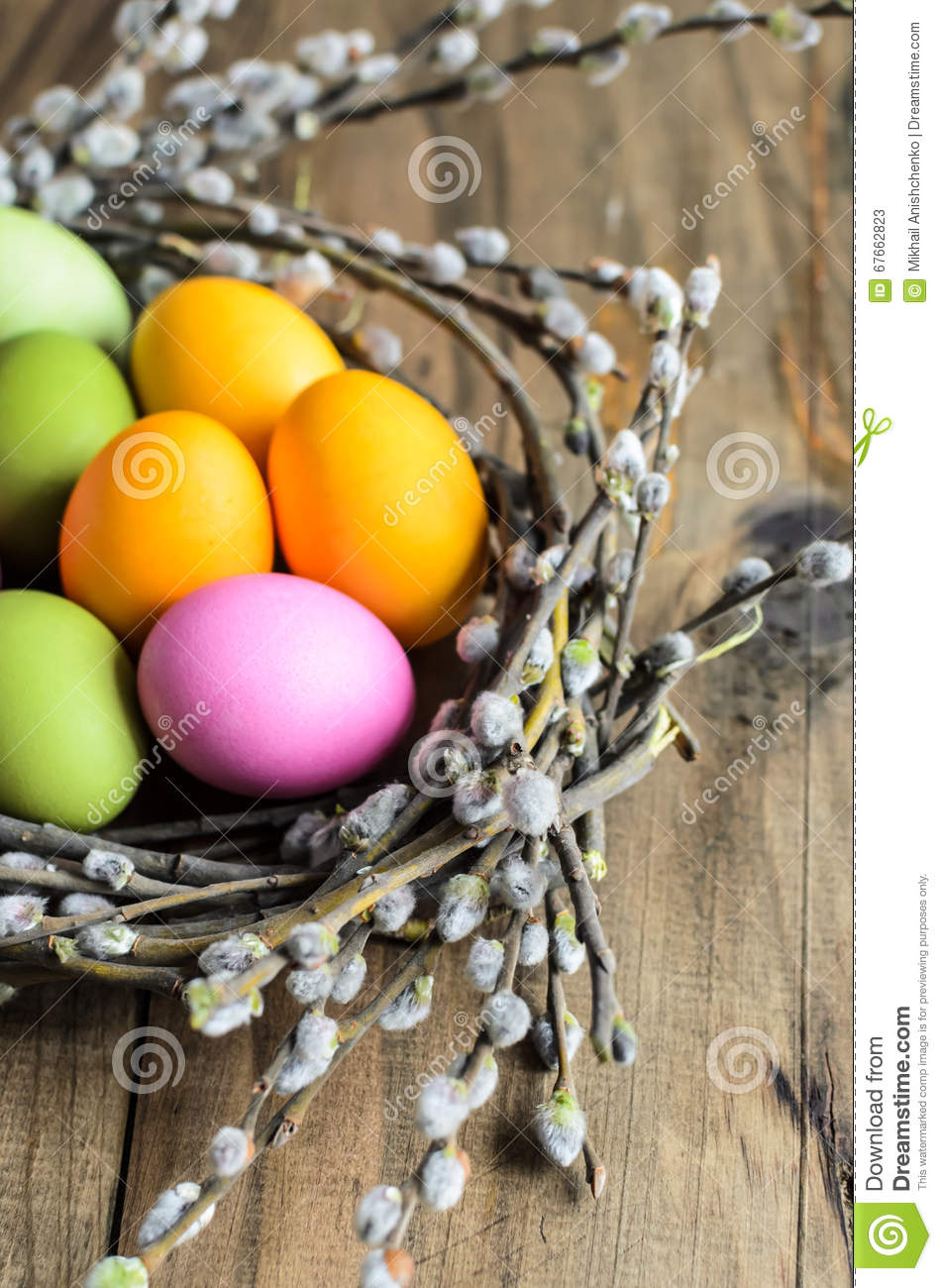 Easter Eggs In Willow Nest Flowers Over Wooden Rustic Background Stock Photo Image 67662823