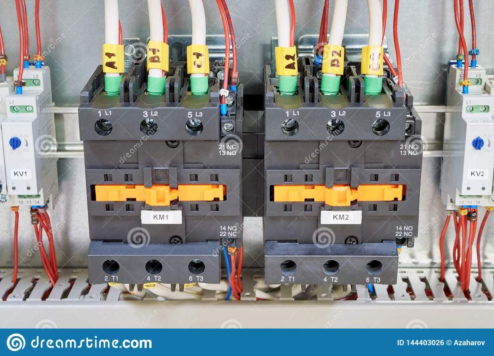 medium resolution of electrical cables and wires are connected to two powerful magnetic starter or contactor on the sides of the modular time relay with adjustment