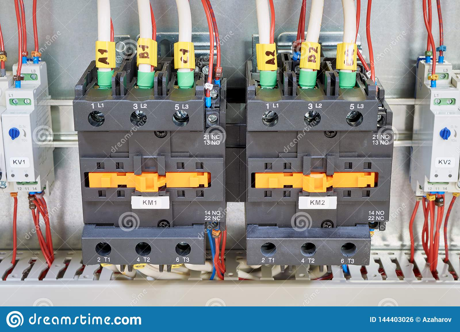 hight resolution of electrical cables and wires are connected to two powerful magnetic starter or contactor on the sides of the modular time relay with adjustment