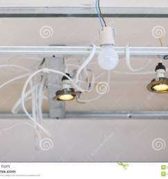 improvement renovation at home electrical installation electric wires hanging on ceiling installing energy light in building site  [ 1300 x 957 Pixel ]