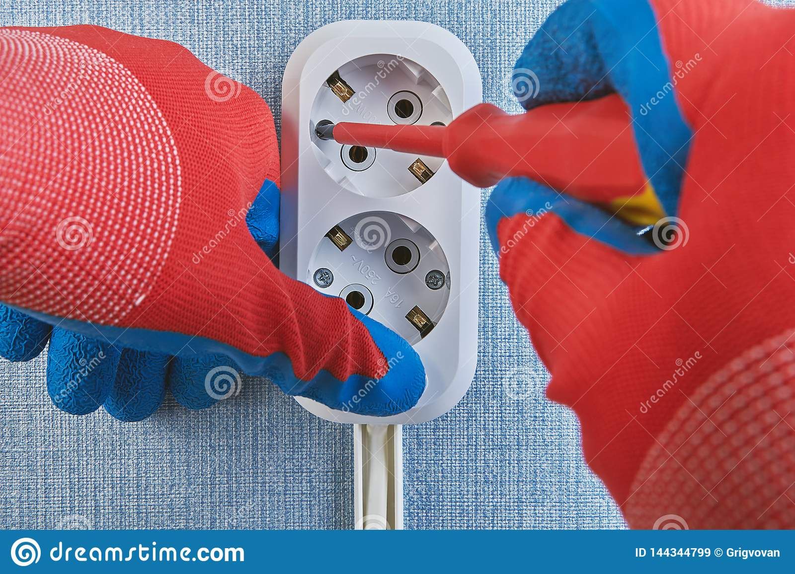 hight resolution of tightening screws by screwdriver during installing wall plug socket residential wiring work hands house power energy electricity protection wire working
