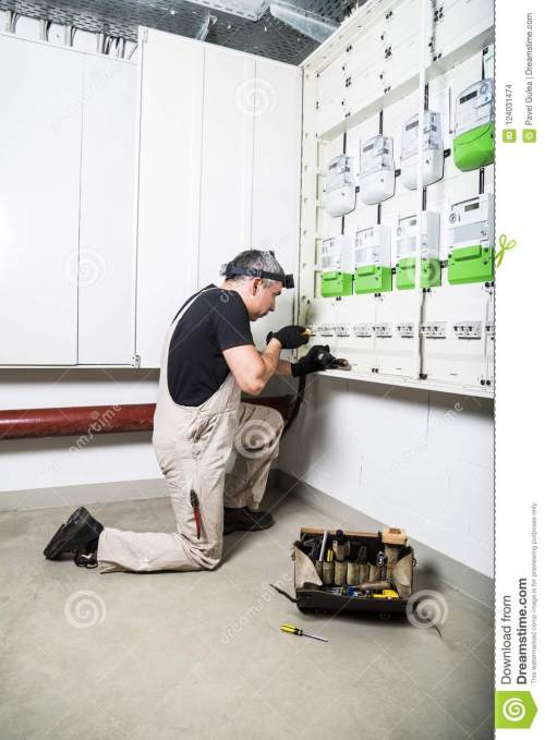 small resolution of electrician with box of tools fixing fuse box or switch box stockelectrician standing near fuse box