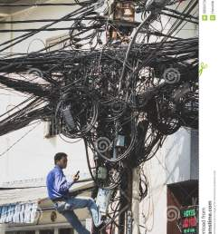 saigon vietnam january 20 2014 electrician fixing messy cables on telephone mast  [ 957 x 1300 Pixel ]