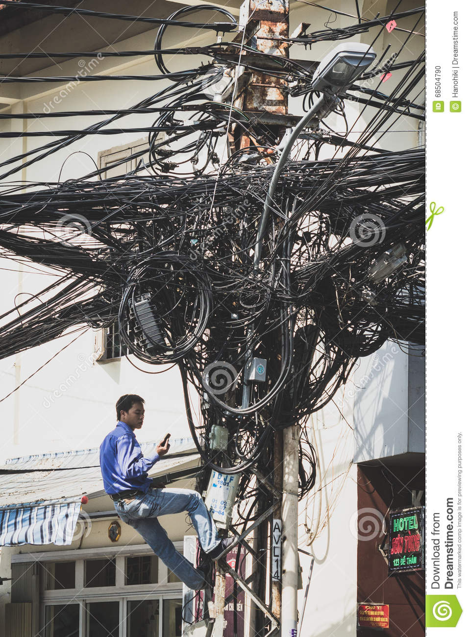 medium resolution of saigon vietnam january 20 2014 electrician fixing messy cables on telephone mast