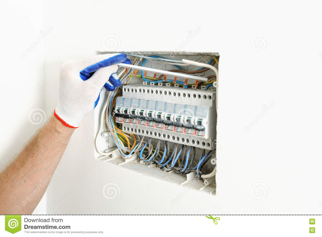 hight resolution of electrician installing an electrical fuse box