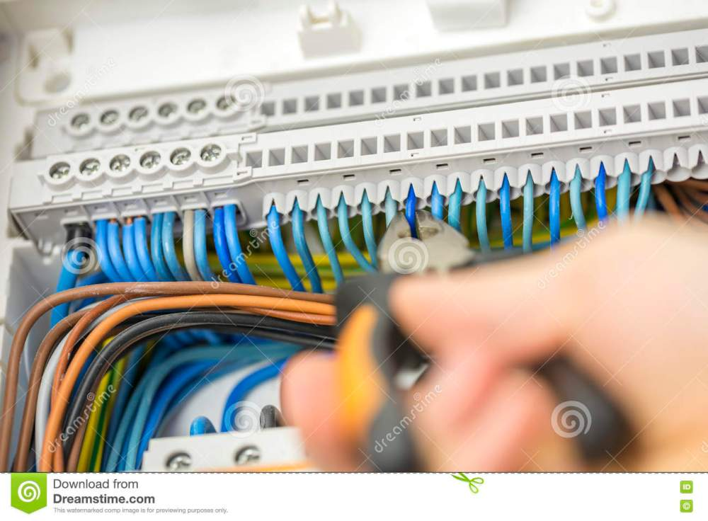 medium resolution of electrician repairing faulty wiring