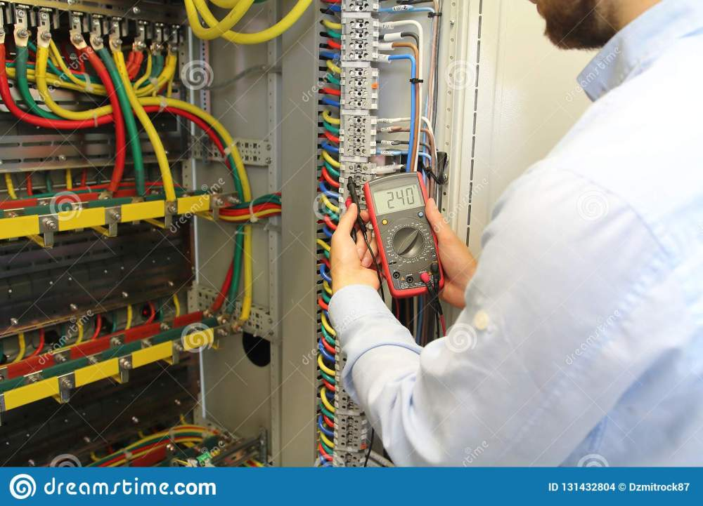 medium resolution of electrician is working in electrical cables distribution fuse box with multimeter