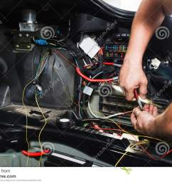 electrician works with electric block in car [ 1300 x 957 Pixel ]