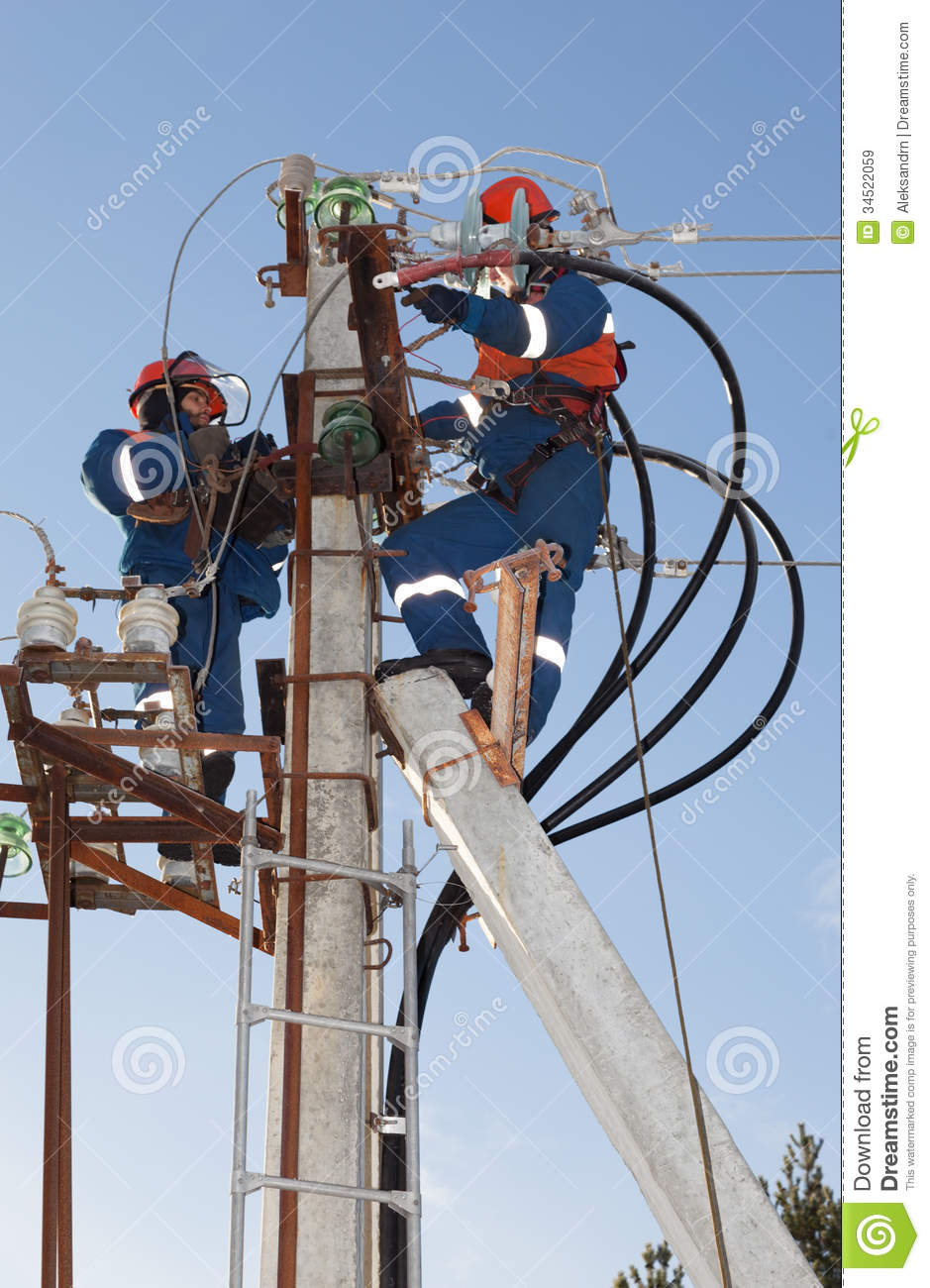 Electricians Troubleshoot On Power Lines Royalty Free