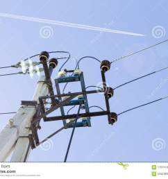 electricity transmission pole high voltage equipment power lines and wires against blue sky  [ 1300 x 957 Pixel ]