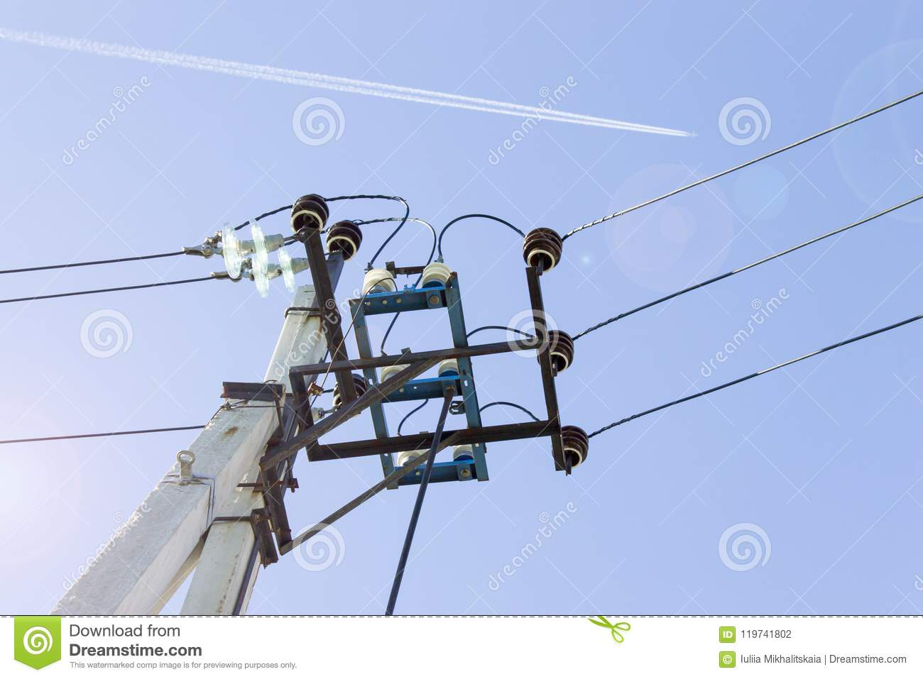 hight resolution of electricity transmission pole high voltage equipment power lines and wires against blue sky