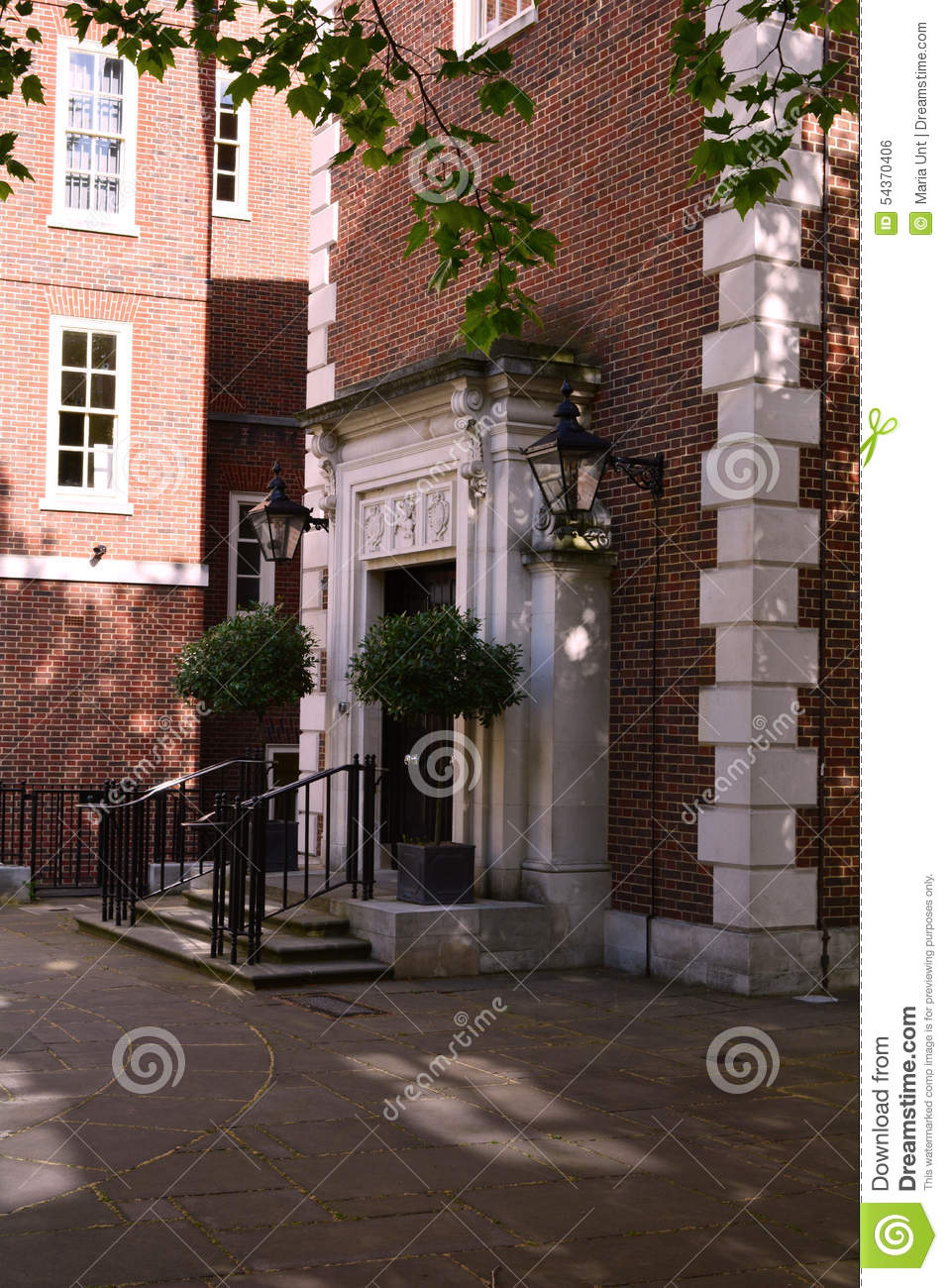 Elegant Red Brick Building Entrance With Stairs Near