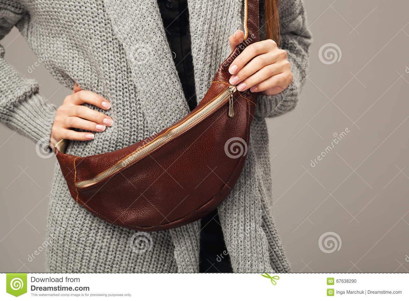 Elegant Woman With A Leather Fanny Pack Stock Photo