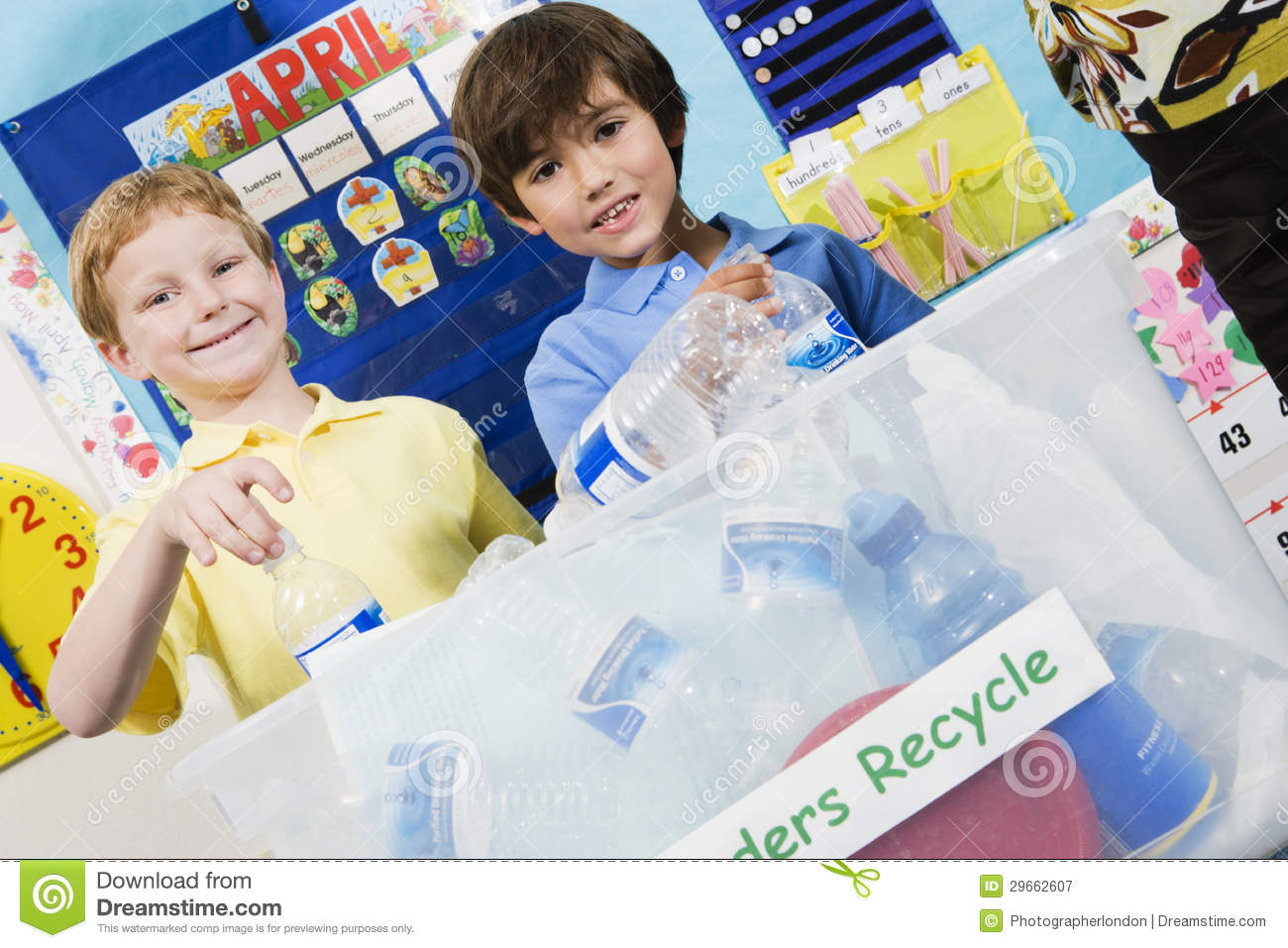 Elementary Students With Recycling Container Royalty Free