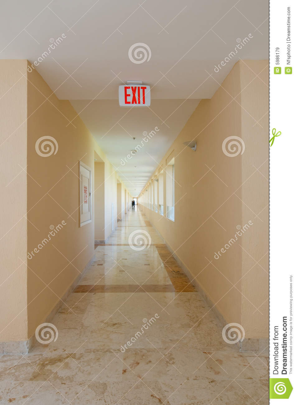 Emergency Exit Sign In Hallway Royalty Free Stock Images