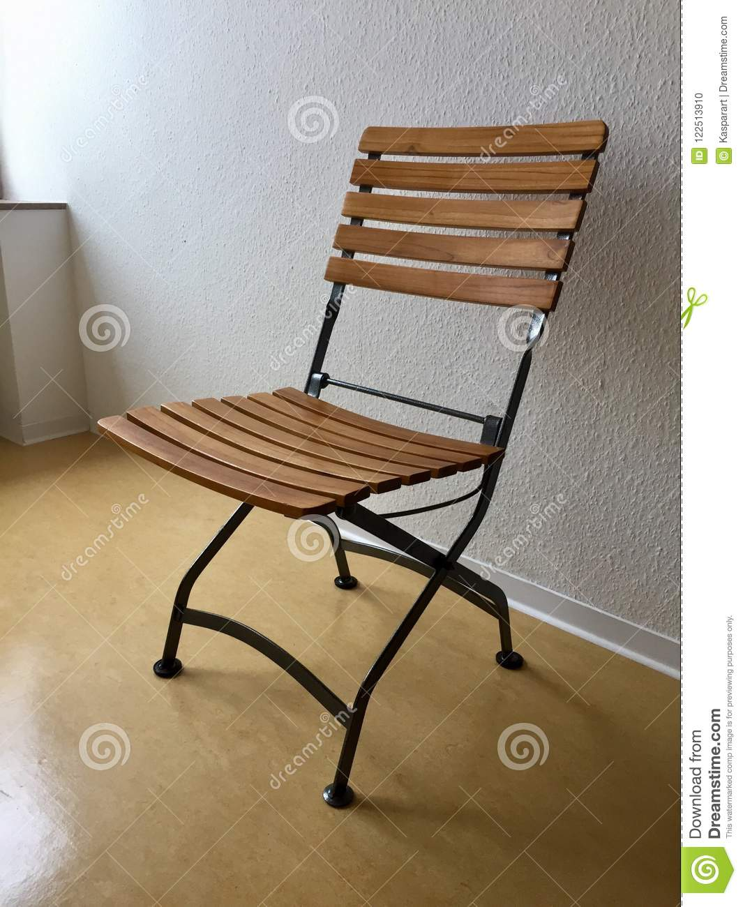 Collapsible Chair Empty Collapsible Chair At A White Wall Stock Photo Image Of