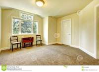 Empty Room With Yellow Walls And Brown Carpet. Stock Photo