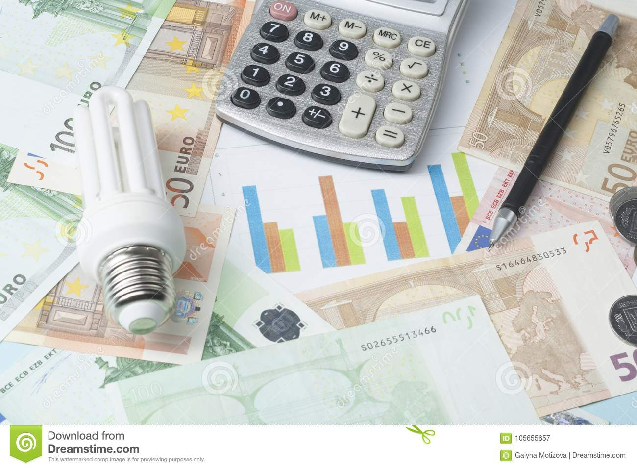 hight resolution of energy saving lamp chart and calculator on money background energy saving saving electricity concept