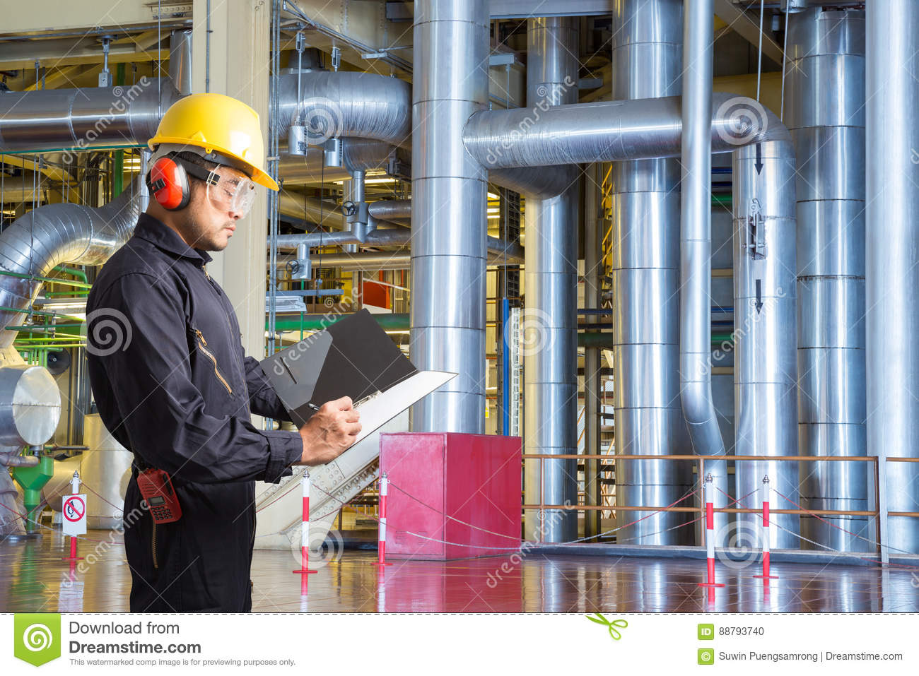 Engineer Taking Notes For Maintenance Work In Powerhouse